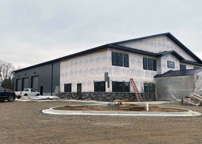 contractors-working-on-exterior-of-new-commercial-building